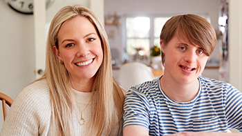 young man with downs syndrome and caregiver