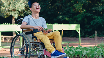 young asian man in wheelchair